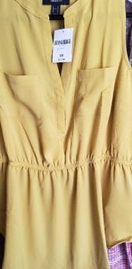 Yellow sleeveless top with empire waist